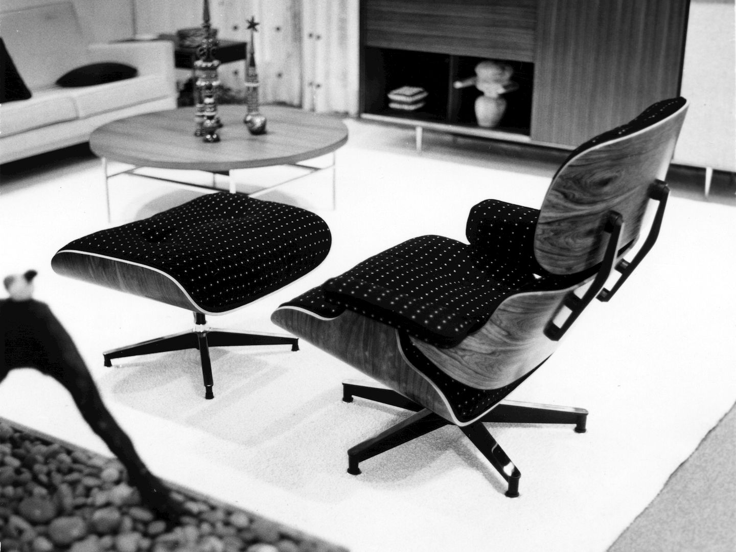 an eames lounge chair in fabric really